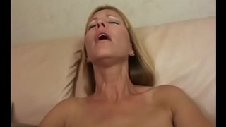 Wild blond MILF with amazing rack Nicole Moore slurps and sucks mutant ebony cock